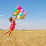 young jumping woman with balloons